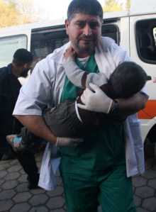 Medic holds child