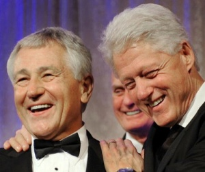 Senator Chuck Hagel (L) enjoys a laugh w