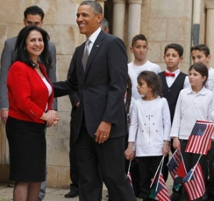 U.S. President Obama is seen next to Bethlehem Mayor Baboun at the Church of the Nativity in Bethlehem