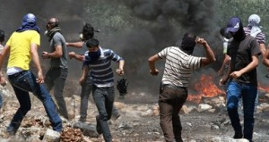Palestinian protesters clash with Israeli security forces on the West Bank in June.