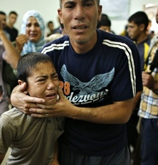 A Palestinian boy cries as compound is evacuated
