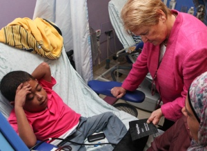 Gro Harlem Brundtland at a hospital in East Jerusalem which also Elders treats patients from Gaza and the West Bank, October 2012